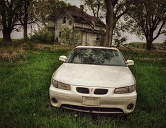 life in the slow lane.... (BillsExplorations) Tags: abandoned decay ruraldecay rust forgotten car abandonedcar pontiac granprix abandonedillinois vintage grass tree abandonedhouse abandonedfarm house field neglected