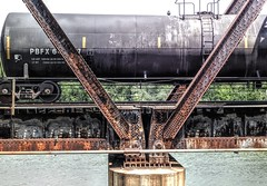 Iron Crossing (clarkcg photography) Tags: bridge train railroad beams rivets girder railroadtracks railroadcars tankcar
