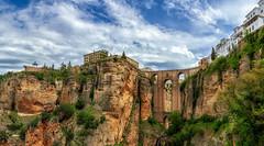 Puente Nuevo (Trevor Bowling) Tags: bridge andalucia spain vally cliff sky clouds bush tree blue ravine puentenuevo roman romanbridge sunlight colours espana