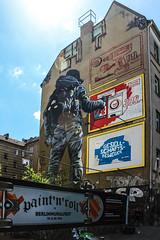 Sprayed Advertising (JuliSonne) Tags: streetart urbanekunst mauer wall graffiti colors scene urban pasteup stencil street berlin muralfestivalberlin mural mto warschauerstrase