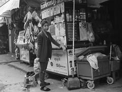 The coffee seller, Phnom Penh, Cambodia, May 2018. La vendeuse de café, Phnom Penh, Cambodge, mai 2018. (vdareau) Tags: noretblanc blackandwhite vendeusedecafé coffeeseller vendeur veudeuse seller café coffee photographiederue streetphotography phnompenh cambodia cambodge asiedusudest southeastasia asie asia a