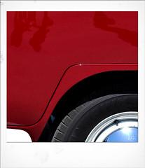Jus_Polaroids09 (reinhard_srb) Tags: artwork polaroid automarke automobil oldtimer ausstellung logo farbe fahrzeug historisch detail karosserie blech lack design spiegelung glanz sammler vw volkswagen bus bully t1 rot felge reifen rad