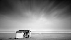 Low Season on the Beach (panfot_O (Bernd Walz)) Tags: beach sea seascape beachhut lowseason balticsea warnemünde emptiness minimalism minimalistic blackandwhite bnw bw monochrome fineart longexposure clouds wind ndfilter
