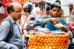Ram Ladoo Vendor, New Delhi India (AdamCohn) Tags: adamcohn delhi india newdelhi food moongdaalfritters ramladoo streetfood streetfoodvendor streetphotographer streetphotography streetvendor vendor wwwadamcohncom