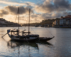 Rabelo boats on the Douro (Oleg S .) Tags: sunset river water flickr porto boat reflection vehicle douro portugal