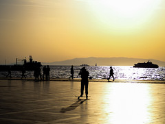 Concentrate to move (Gokhan H.) Tags: skater skating view sun sunset people reflection sea olympus m43