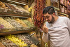 Adult male merchant carefully inspects flower tea in spice shop in Istanbul Spice bazaar in Turkey (Remsberg Photos) Tags: bazaar market souk spice istanbul turkey egyptianbazaar commerce business retail shopping exchange commodities vendor portrait adult male merchant forsale inspect examine marketplace products middleeast consumerism chestnuts roasted castanea nut streetfood snack medicine holistic economy