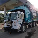 Trash Truck in the Morning Sun thumbnail