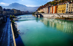 River front in Grenoble, France (` Toshio ') Tags: toshio grenoble france isere isereriver river europe french water mountain european europeanunion buildings city path road reflection fujixt2 xt2 riverbank bridge