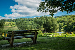 Sit and ask the Wye (The Frustrated Photog (Anthony) ADPphotography) Tags: category england gloucestershire hdr landscape lydbrook places travel river bench tree trees water sky whiteclouds canon1585mm canon70d canon landscapephotography travelphotography greenery countryside rural nature natural outdoor seat wood grass forest field park