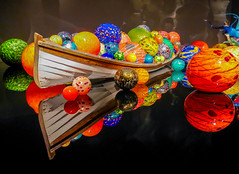 Balls in a boat (Adaptabilly) Tags: sculpture glass usa washington art travel lumixgx7 reflection ball chihuly boat indoors gallery seattle colour unitedstates us