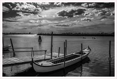 Senza titolo 135 (Outlaw Pete 65) Tags: paesaggi landscapes cielo sky nuvole clouds luce light acqua water pali poles barca boat biancoenero blackandwhite fujixe3 fujinon1855mm cavallinotreporti veneto italia