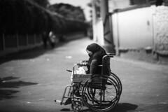 Ghairon Se Ab Sunaa Karo Naghmein Bahaar ke (N A Y E E M) Tags: oldlady beggar disabled wheelchair afternoon light today street gmroad chittagong bangladesh carwindow tribute hommage homage ghulamali khalidmehmoodarif
