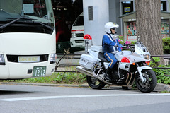 Japanese motorcycle police officer (CooverInAus) Tags: tokyo police honda motorcycle policeman officer bus ambulance fire japan japanese number license registration plate