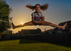 happy student (michel_vdm) Tags: sunset golden hour jumping fun student sun young girl legs