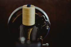 haberdashery... (Jess Feldon) Tags: mellowyellow yellow colourfusion colour dof depth macro bokeh singersewingmachine sew cotton lookslikefilm jessfeldon vintage bobbin thread haberdashery