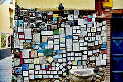 A piece of wall in Albenga/Liguria with many metal signs (paaddor) Tags: lifestyle landscape beautiful picturesque city travelattraction awesome traveling photography adventures travelphotography lovely plants photo animals happy colors nikond3400 cute building sun explore worldplaces travellingthroughtheworld wonderful cool travel