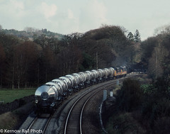 Climbing away from Respryn (Kernow Rail Phots) Tags: kernow cornwall class37 37420 thescottishhosteller 37417 highlandregion intercity 6s55 0950 burngullow irvine tanks chinaclay china clay respryn sunday 8th march 1992 bodminparkway bodmin silver bullets scenic trees railways railway railroad trains tain freight britishrail br silverbullets