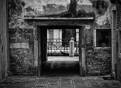 Old Dark Passage (henriksundholm.com) Tags: opening entrance exit passage shadows alley flagstones brick wall bw blackandwhite monochrome city urban street decrepit contrast venice venezia italy veneto