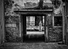 Old Dark Passage (henriksundholm.com) Tags: opening entrance exit passage shadows alley flagstones brick wall bw blackandwhite monochrome city urban street decrepit contrast venice venezia italy veneto