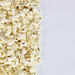 A pile of popping popcorn against a white background.jpg