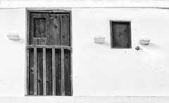 The facade (in Explore) (pacogranada) Tags: puerta ventana window door bw blancoynegro casa blanco negro explore