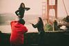 Something in the air (.KiLTRo.) Tags: sanfrancisco california unitedstates us kiltro goldengatebridge bridge people clouds gente puente red rojo photo pose fun smile