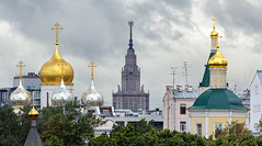 the battle over dominance in public space aka advertising the right cause (Goetz Burggraf) Tags: moskva moscow russia rus russianfederation europe redstar sovietstar sovietarchitecture churches holycross building sky tower city tree architecture © ©goetzburggraf|götzburggraf