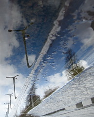 Tramway Attraction (andressolo) Tags: reflections reflection reflected reflect reflejos ripples reflejo distortions distortion distorted water city clouds urban streetlights tram