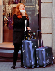 Looking for a taxi (chrisk8800) Tags: visitor tourist asian luggage facemask waiting looking barcelona redhead