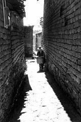 Once upon a time in Yunnan~ China (~mimo~) Tags: travel documentary tradition hat old alley blackandwhite honghe village china farmer yunnan