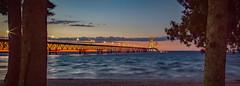 The Bridge between the Trees (T P Mann Photography) Tags: lakehuron lakemichigan mackinaccity mackinacbridge straitsofmackinac color sunset sundown dusk landscape seascape lake sea bridge greatphotographers