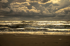 stirred up (Wöwwesch) Tags: ocean seascape clouds waves beach light sunset sea storm refelection sunrays sand water northsea wave
