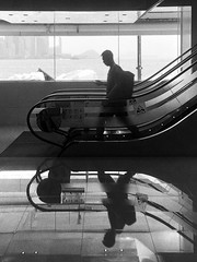 (perryge) Tags: tsimshatsui film leicaiiif industar2250mmf35 ilfordhp5 hc110 blackandwhite urban streetphotography architecture symmetry people man silhouette walking escalator kowloon hongkong city reflection sovietlens