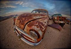 my good side (Maureen Bond) Tags: ca desert maureenbond cars automobiles classics vintage junkyard abandoned chrome bumper headlight rusty crusty patina clouds sunset twilight beuatiful fisheye