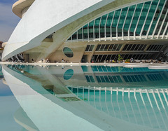 Reflected life (Adaptabilly) Tags: shadow pattern bicycle santiagocalatrava window people ciudaddelasartesylasciencias lumixgx7 spain woman travel sky palaudelasartes building architecture cityofartandscience wall valència reflection water europe