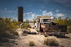 Lanfair Road, Mojave National Preserve, California (paccode) Tags: wreck d850 bicycle landscape desert bushes brush quiet california abandoned silo nationalpark dump solemn creepy mojave forgotten tires urban unitedstates us