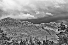 Beinn a' Mhùinidh and Meallan Ghobhar from Beinn Eighe NNR (Francis Mansell) Tags: beinnamhùinidh meallanghobhar hillside hill mountain crag mountainside monochrome blackwhite sky cloud tree pine scotspine woodland beinneighenationalnaturereserve loch lochmaree highlands scotland scottishhighlands westerross cliff
