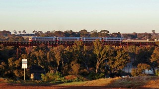 4x 'Sprinter' railcars cross the Melton Weir with an early morning passenger service to Melbourne.