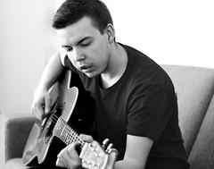 Jarand (livsillusjoner) Tags: guitar instrument music playing play playingmusic boy man young hand hands monochrome bw blackwhite blackandwhite sing singing