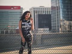 City girl (Vincent F Tsai) Tags: portrait fashion urban city street style buildings skyline girl light sun bokeh dof environmental rock raleigh nc leicadgnocticron425mmf12 panasonic lumixgx8
