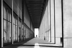 Berlin (www.streetphotography-berlin.com) Tags: berlin street streetphotography streetlife monochrome blackandwhite blackwhite europe architecture arcade passage woman alone perspective lines light shadow fineart