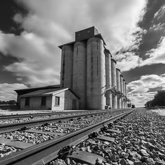 Have a kick! (OzzRod (on the road again)) Tags: blackandwhite monochrome grain silos railway track mirrool riverina nsw mirroolsilokick laowa12mmf28 k1 pentax