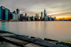 Chicago Skyline from Milton Lee Olive Park (pauliefred) Tags: city skyline water lake river longexposure dusk buildings architecture sun sunset sky clouds chicago illinois unitedstates