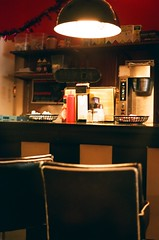 Mecca Holidays (Anne Abscission) Tags: seattle washington queenanne meccacafe themecca oldbuildings interior holidaydecor dining barstools stripes coffee availablelight pnwlife seattleicon filmphotography 35mmfilm analog olympustrip35 olympustrip ishootfilm staybrokeshootfilm filmisnotdead fujifilm fujisuperia