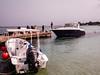 F7192E7 - Express Cruiser Docks To Pick Us Up (Bob f1.4) Tags: boat dock express cruiser wellcraft portofino coming docking water caribbean sea roatan island honduras infinity bay resort west beach