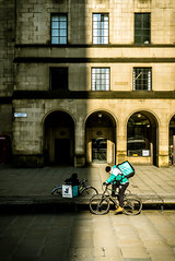 Two Riders were Approaching (Mike Kniec) Tags: bike manchester bicycle bicyclist deliveroo sony sonya7 delivery uk manchesterphotos artisticbike delivering deliveroodriver deliveroobicyclist