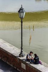 By the river (lasse christensen) Tags: dsc2436 italiaitaly pisa river elv arno gutt jente boy girl gatebelysning streetlighting