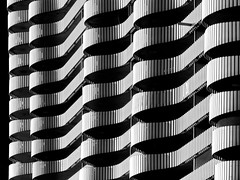 city-gate-waves (heinzkren) Tags: austria wien vienna kagran building bauwerk gebäude architektur architecture schwarzweis blackandwhite bw sw linien lines wellen panasonic lumix geometrie geometry facade fassade hochhaus skyscraper urban modern structure abstract tower citygate wohnbau wohnhaus licht shadow pattern monochrome light balcony balkon design