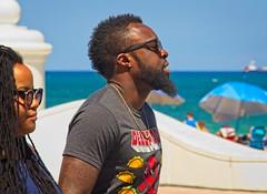 Black man and girlfriend (LarryJay99 ) Tags: 2018 beach streets people ftlauderdale ocean atlanticocean blackman glasses beards facialhair mustasche profile tattoos tatts horizon black blackpeople